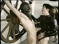 Domme taunts tied man with..