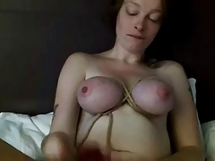 Tied tits and toys in pussy..