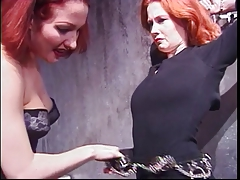 Curvy redhead shackled by..