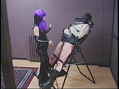 Dominatrix pours hot wax on..