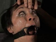 Gagged girl with clamped..