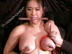 Busty asian bdsm and needle..