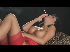 Smoking brunette in red..