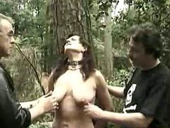 Hot slave tied to a tree..