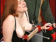 Fat corseted redhead with..