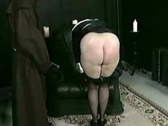 Horny nun slave is spanked..