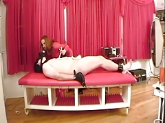 BDSM dominatrix makes him..