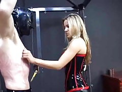 Dominatrix spanks, slaps,..