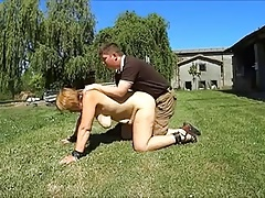 Horny mature on the grass