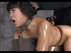 Asian girl tied, gagged,..